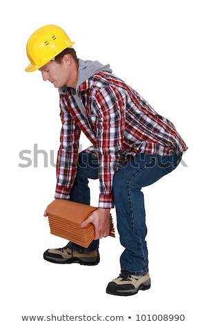 tradesman lifting shingles stock photo © photography33