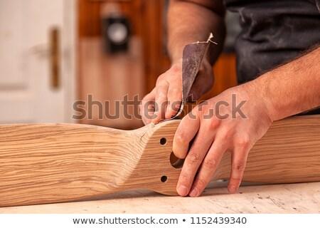 mans hand on sanding block on pine wood stock photo © backyardproductions