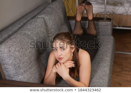 женщину · диване · красивой · улыбаясь · молодые - Сток-фото © elenaphoto