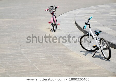 Two bikes on walkway in the park. Stock photo © rglinsky77