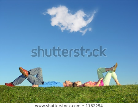 Family on herb under blue sky lie Stock photo © Paha_L