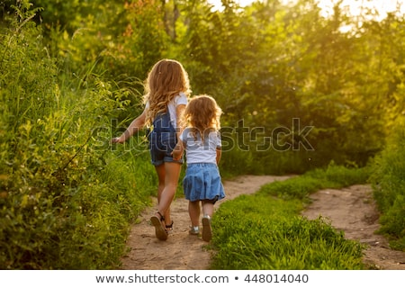 Two little cute girls on lawn in the park Stock photo © HASLOO