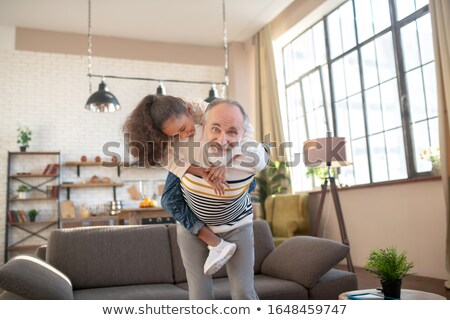 family holding back grandfather and having fun stock photo © get4net