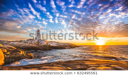 Lighthouse at Peggy's Cove, Nova Scotia at sunset Stock photo © RAM