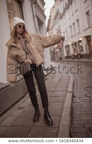 pretty woman wearing winter outfit and sunglasses stock photo © hasloo
