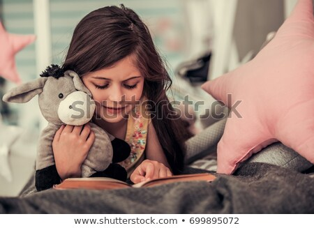 adorable little girl with toy donkey stock photo © escander81