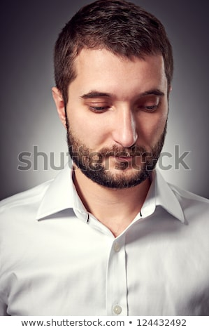 sad young bearded business man looking down  Stock photo © feedough