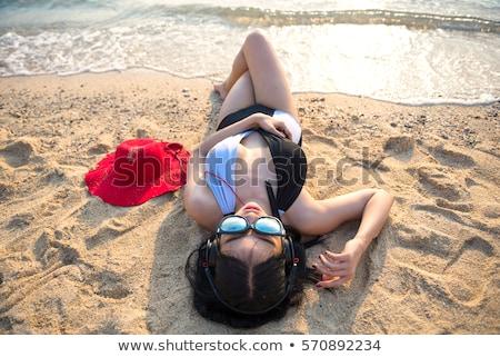 Szexi fiatal nő zenét hallgat nyalóka fejhallgató óvatlan Stock fotó © stevanovicigor