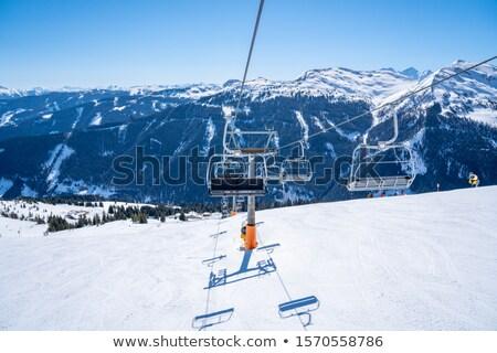 Ski lift with seats going over the mountain Stock photo © alex_grichenko