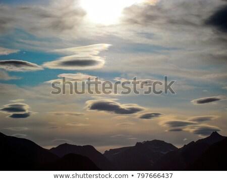 Estranho nuvem nuvens azul deserto céu Foto stock © emattil