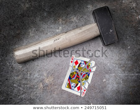 hammer with a broken card queen of clubs stock photo © michaklootwijk
