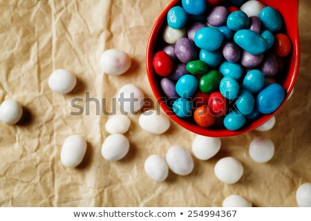 colorful candies like sea pebbles on craft paper stock photo © dariazu