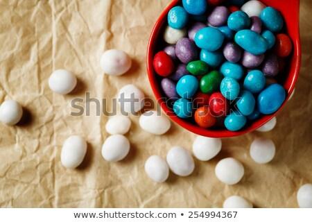 Színes cukorkák ahogy tenger kavicsok papír Stock fotó © dariazu
