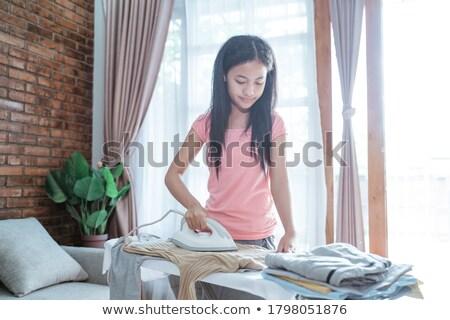 Teen girl ironing shirt.  Stock photo © iofoto