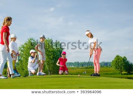 девушки · гольфист · улыбающаяся · женщина · зеленый · озеро - Сток-фото © janpietruszka