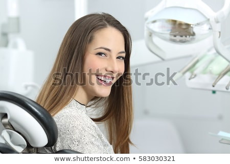 Dentist examining a patients teeth in the dentists chair Stock photo © wavebreak_media