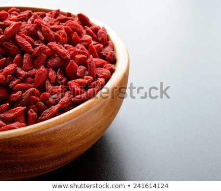 Stock photo: Heap Of Dry Goji Berries On The Dark Table