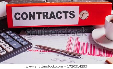 Piros gyűrű felirat dolgozik asztal irodaszerek Stock fotó © tashatuvango