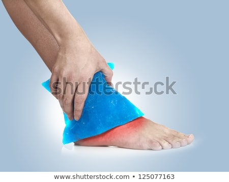 woman with ice pack on ankle  Stock photo © Flareimage