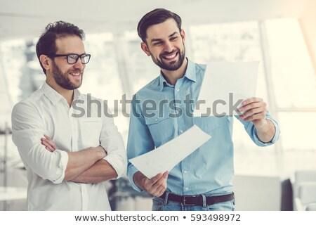 üzletember · megvizsgál · iratok · fiatal · felnőtt · bent · üzlet - stock fotó © imagedb