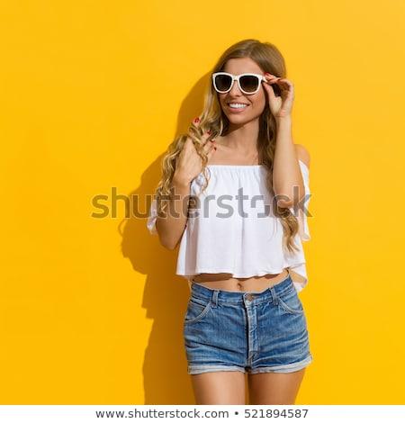 Szőke hosszú haj lány farmer rövidnadrág nyár Stock fotó © lunamarina