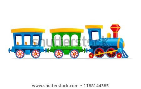Locomotiva brinquedo amarelo verde vermelho isolado Foto stock © Alsos