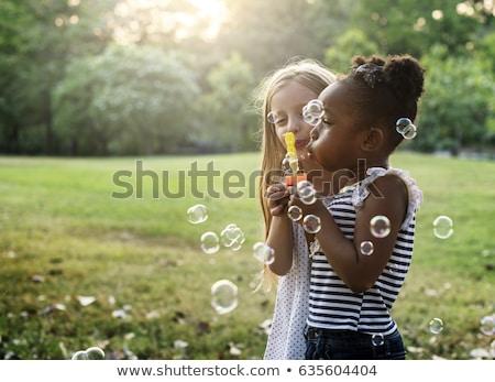 Csoport buborékfújás nyár gyerekek mosolyog haj Stock fotó © godfer