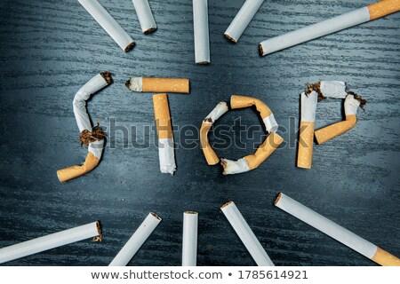 Quit smoking concept, flat lay arranged cigarettes Stock photo © stevanovicigor