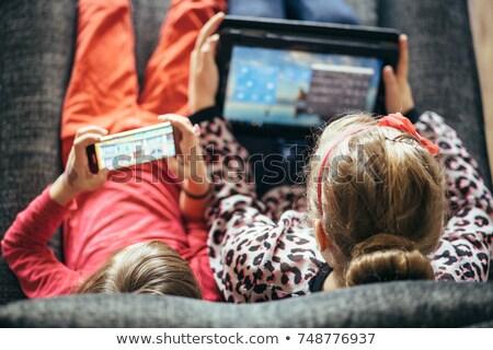 Nino jugando tableta teléfono Cartoon Foto stock © doddis