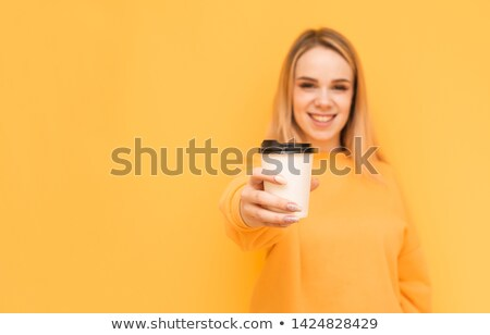 Young beautiful blonde girl drinking coffee from take away cup Stock photo © deandrobot