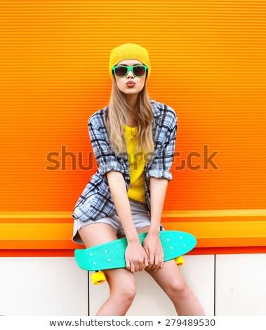 фигурист девушки Солнцезащитные очки красивой скейтборде Сток-фото © keeweeboy