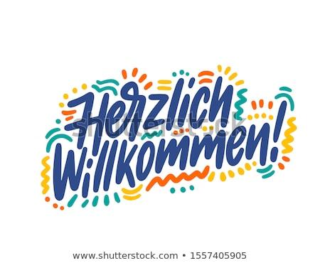 Herzlich willkommen welcome sign in German Stock photo © adrian_n