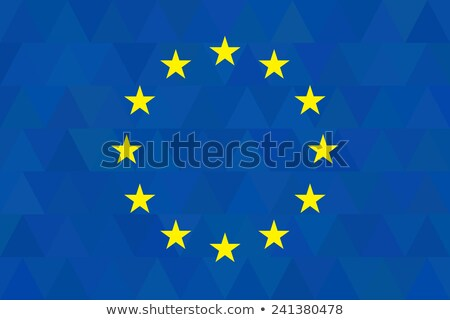 European union flag on unusual blue triangles background. Triangular design. Original proportions an Stock photo © JeksonGraphics