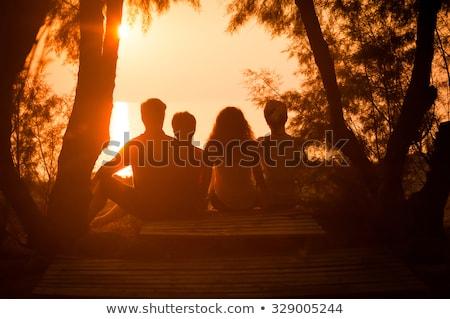 silhueta · família · pôr · do · sol · costa · céu · mão - foto stock © szefei