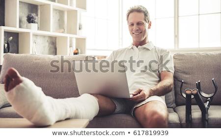Injured businessman with broken leg. Stock photo © RAStudio