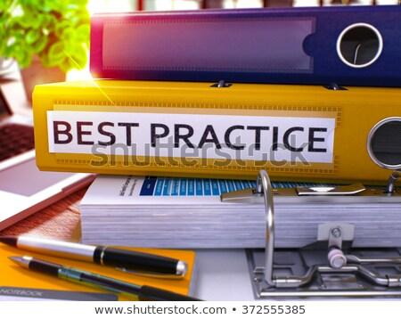 Best Practice on Yellow Ring Binder. Blurred, Toned Image. Stock photo © tashatuvango