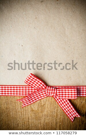 cutting board with red ribbon bow Stock photo © Digifoodstock
