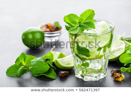 mojito cubano or caipirinha cocktail iced drink with lime and mint stock photo © yelenayemchuk