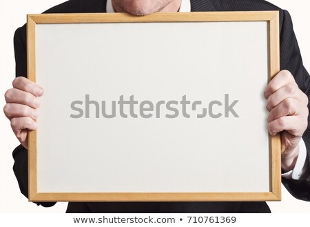 Blank Whiteboard Sign Held Up by Businessman in Suit Stock photo © frannyanne