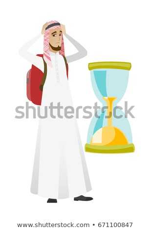 Worried muslim traveler man looking at hourglass. Stock photo © RAStudio