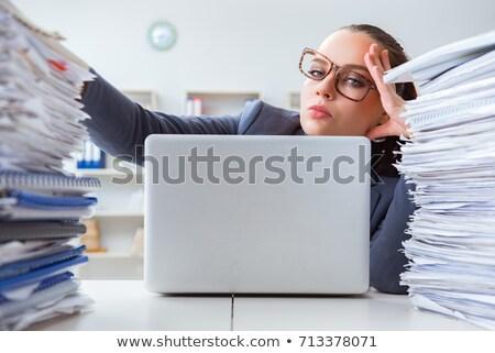 Tired businesswoman with paperwork workload Stock photo © Elnur