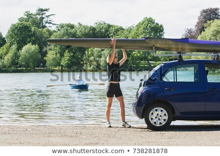 Woman lifting canoe off car Stock photo © IS2