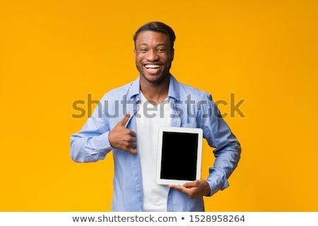 улыбаясь африканских человека экране Сток-фото © deandrobot