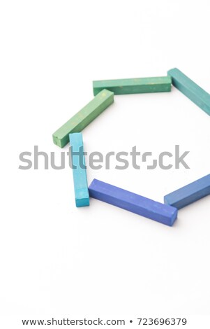 Cropped photo of colorful chalks in geometric composition Stock photo © deandrobot
