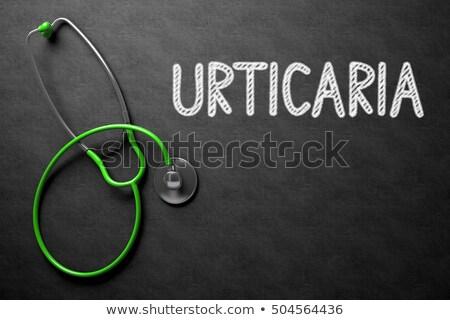 Urticaria Concept on Chalkboard. 3D Illustration. Stock photo © tashatuvango