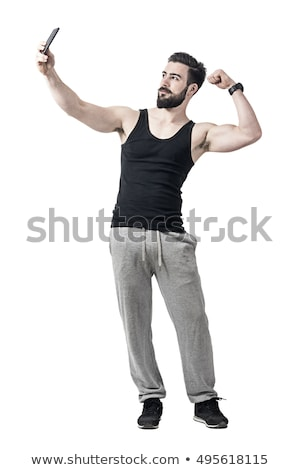 full length photo of young attractive muscular man workout with stock photo © deandrobot