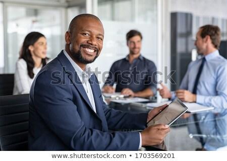 группа портрет конференц-зал служба бизнесмен костюм Сток-фото © IS2