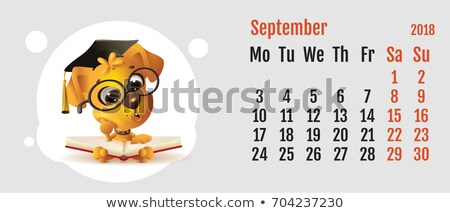 2018 year of yellow dog on Chinese calendar. Fun dog reading book. Calendar grid month September Stock photo © orensila