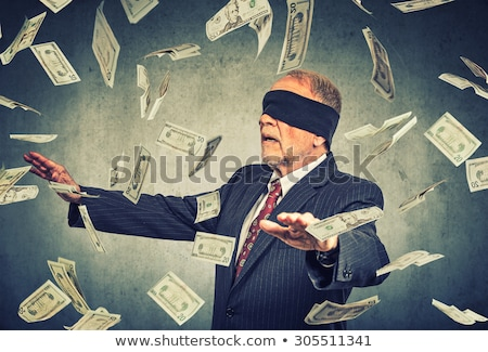 Man trying to catch dollar bill Stock photo © ichiosea