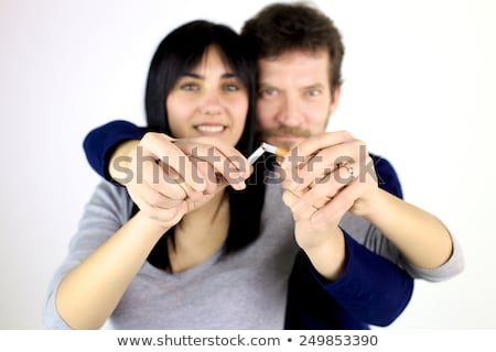 Man breaking cigarette in two Stock photo © icefront